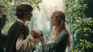"Disney's ""Maleficent"" L to R: Prince Phillip (Brenton Thwaites) and Aurora (Elle Fanning) Ph: Film Frame ©Disney 2014"